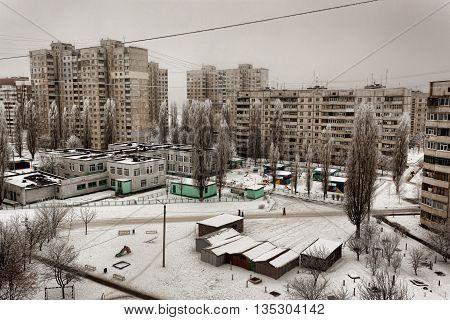 The courtyard between the Kharkiv Soviet-built apartment blocks cloudy winter day. Ukraine February 2015