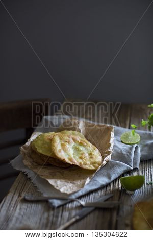 Indian Puri flat bread with avocado on a gray background tradition of India