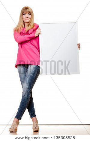 Advertisement concept. Fashion woman full body with blank presentation board. Female model showing banner sign billboard copy space for text. Isolated