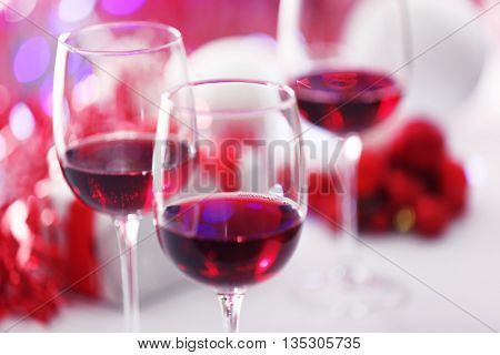 Wineglasses on red blurred lights background