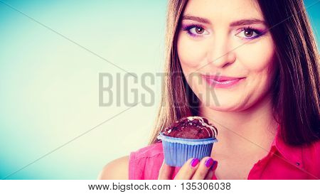Smiling Woman Holds Chocolate Cake In Hand