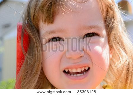 Portrait - Little Girl's Face Contorts