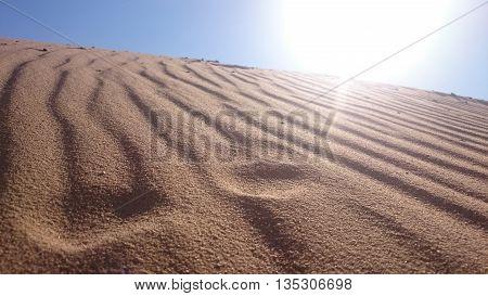 Sand and sun in aqaba desert hot day