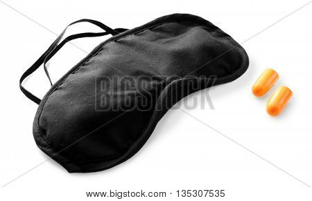 Sleeping mask and earplugs, isolated on white
