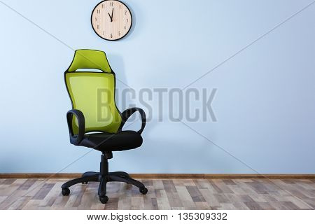 New office chair on wall background