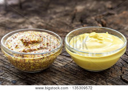 Dijon Mustard And Mustard On Wooden Background