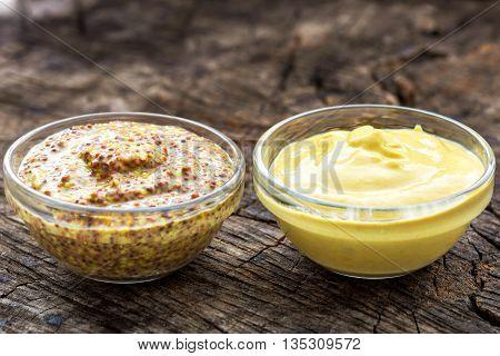 Dijon Mustard And Mustard On Wooden Background