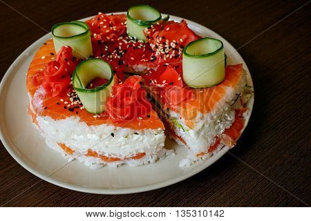 Salmon Sushi Cake with nigiri, soy sauce, cucumber, salmon, avocado, caviar nori sesame Cutoff