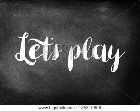 Lets play written on chalkboard