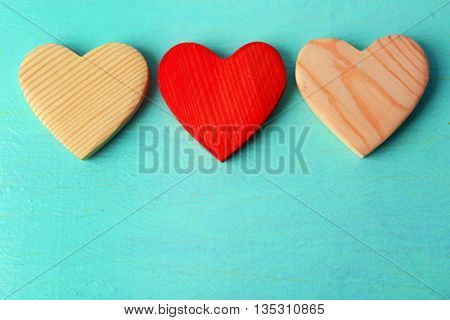 Wooden hearts on color wooden background