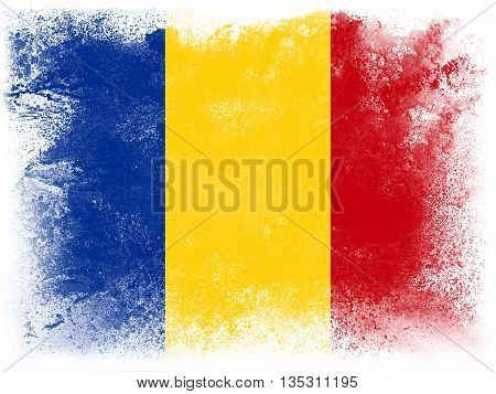 Powder paint exploding in colors of Romania flag isolated on white background. Abstract particles explosion of colorful dust.