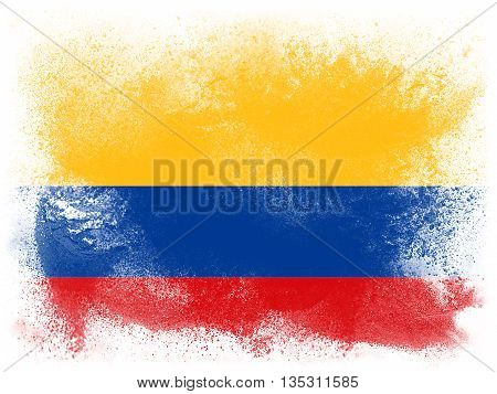 Powder paint exploding in colors of Columbia flag isolated on white background. Abstract particles explosion of colorful dust.