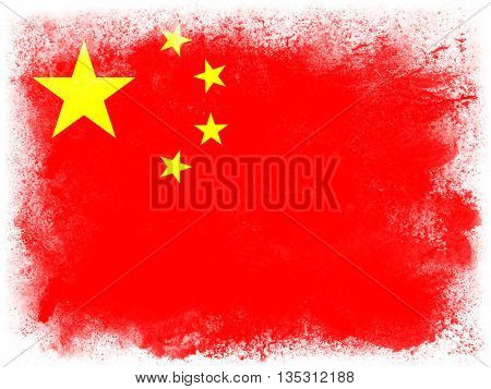 Powder paint exploding in colors of China flag isolated on white background. Abstract particles explosion of colorful dust.