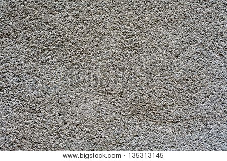 light grey plaster wall for background or texture