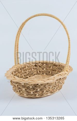 Woven basket isolated on a white background with clipping path. Suitable for use as the object in graphic work.