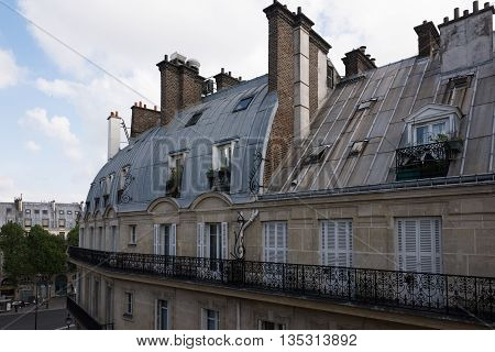 View of mansard roofs of houses in Paris, France