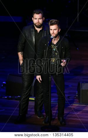 NASHVILLE, TN-SEP 1: Colton Swon (R) and Zach Swon of the Swon Brothers onstage during the 9th Annual ACM Honors at the Ryman Auditorium on September 1, 2015 in Nashville, Tennessee.