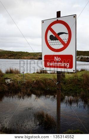 No Swimming Sign next to Open Water, Dartmoor, Devon, UK
