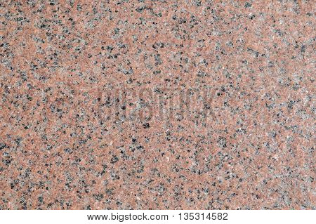Surface of the walls with light pink granite with brown gray and white patches.