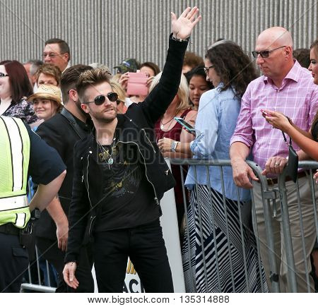 NASHVILLE, TN-SEP 1: Colton Swon of the Swon Brothers waves to the crowd at the 9th Annual ACM Honors at the Ryman Auditorium on September 1, 2015 in Nashville, Tennessee.