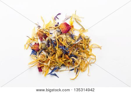 Dried blossoms mix isolated on white background view from above closeup.