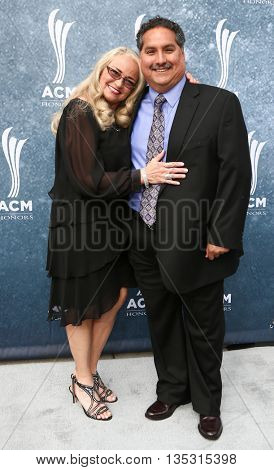 NASHVILLE, TN-SEP 1: Michael Rojas (R) and guest attend the 9th Annual ACM Honors at the Ryman Auditorium on September 1, 2015 in Nashville, Tennessee.