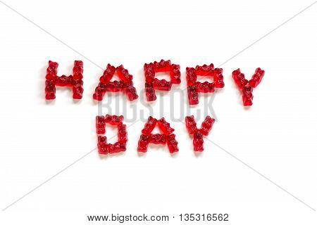 Happy Day letters made from red gummy bears on a white background