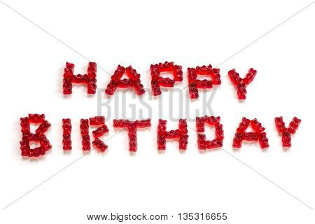 Happy Birthday letters made from red gummy bears on a white background