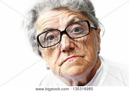 Old grandmother in glasses on a white background