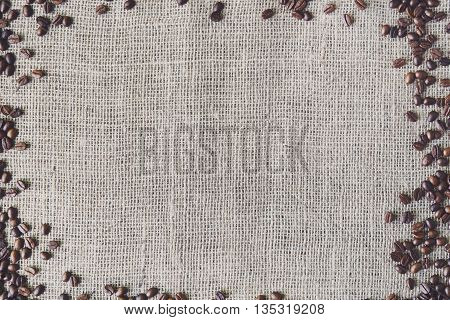 Burlap texture with coffee beans border. Sack cloth burlap texture background. Brown natural sackcloth canvas background with frame and copy space. Coffee border at hessian textile, soft color toning