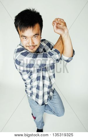 young cute asian man on white background gesturing emotional, pointing, smiling, lifestyle people concept close up