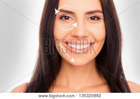 Close Up Portrait Of Happy Cheerful Young Brunette With Arrows On Her Perfect Skin