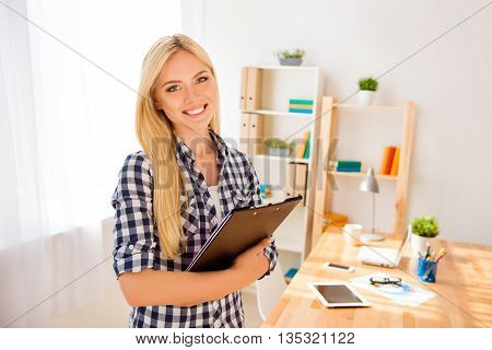 Portrait Of Young Happy Secretary Holding Folder With Documents