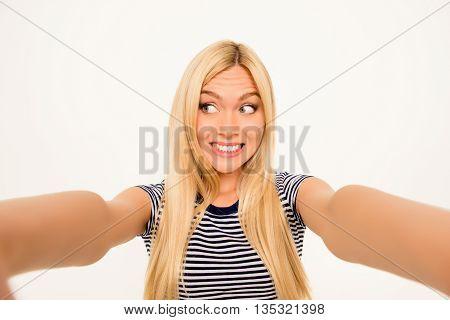 Beautiful Happy Blonde Making Comic Selfie And Grimacing