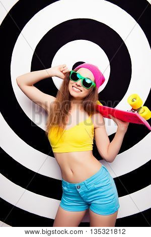 Happy Cheerful Woman In Glasses Holding Pink Skate Board