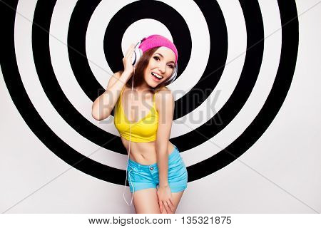 Attractive Young Woman In Headphones Listening Music And Singing