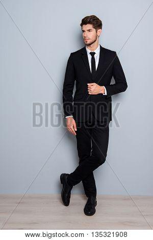 Portrait Of Handsome Confident Young Businessman In Black Suit