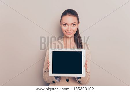 Pretty Smiling Woman Showing Black Screen Of Digital Tablet