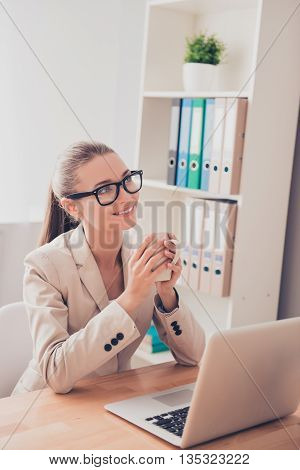 Portrait Of Smiling Woman In Glasses Resting And Drinking Coffee