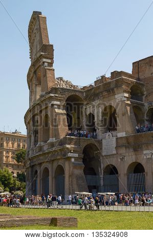 ROME, ITALY - JUNE 6, 2010: Tourists Visiting Colosseum or Coliseum in Rome Italy