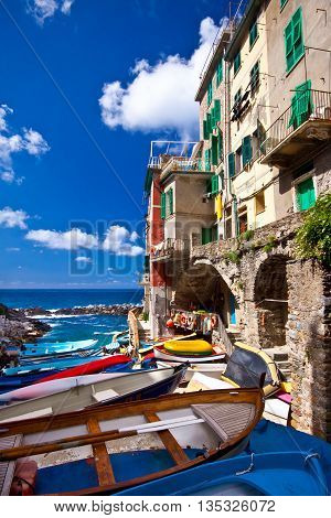 Riomaggiore fisherman village in a dramatic windy weather. Riomaggiore is one of five famous colorful villages of Cinque Terre in Italy.