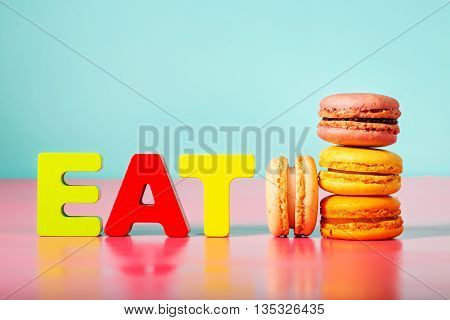 Stack Of Macarons On With Eat Block Letters