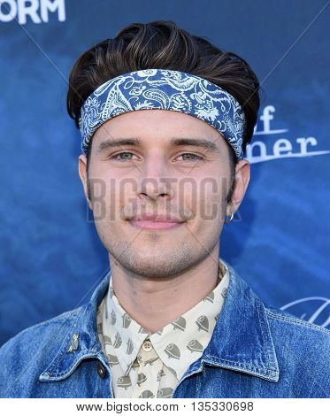 LOS ANGELES - JUN 15:  Ronen Rubinstein arrives to the arrives to the Pretty Little Liars Season 7 Event  on June 15, 2016 in Hollywood, CA.
