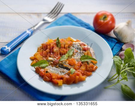 anchovy with capsicum and tomato sauce, selective focus