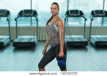 Young Woman Doing Exercise With Kettle-bell
