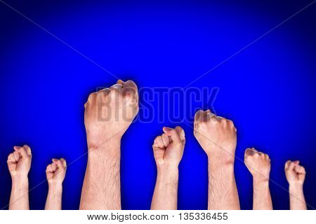 group of human hand showing fist on blue background, fighting fist concept, fist sign or symbol.