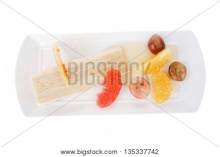 small cream cake slice with tangerine and grapefruit