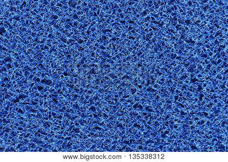 The fabric texturefabric carpet texture in close-up scene.The clean blue plastic fiber texture background.