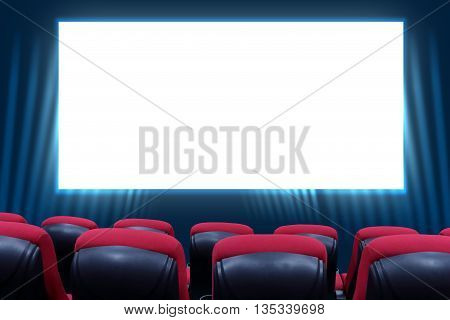 Movie Theater with blank screen and red seats
