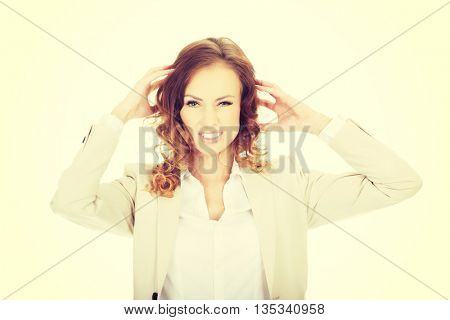 Angry businesswoman screaming.